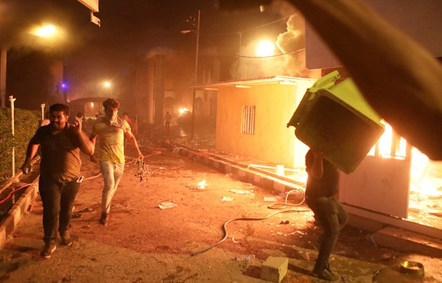 Protesters storm and burn the Iranian consulate building in Basra, 340 miles (550 km) southeast of Baghdad, Iraq, Friday, September 7, 2018. Hundreds of angry protesters in Basra took to the streets on Thursday night. Some clashed with security forces, lobbing Molotov cocktails and setting fire to a government building as well as the offices of Shiite militias. At least three people were shot dead in confrontations with security forces. (Photo by Nabil al-Jurani/AP Photo)