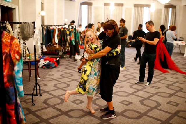 Model Madeline Stuart, who has Down's syndrome, prepares backstage of the Soiree show at London Fashion Week Women's in London, Britain, September 16, 2018. (Photo by Henry Nicholls/Reuters)