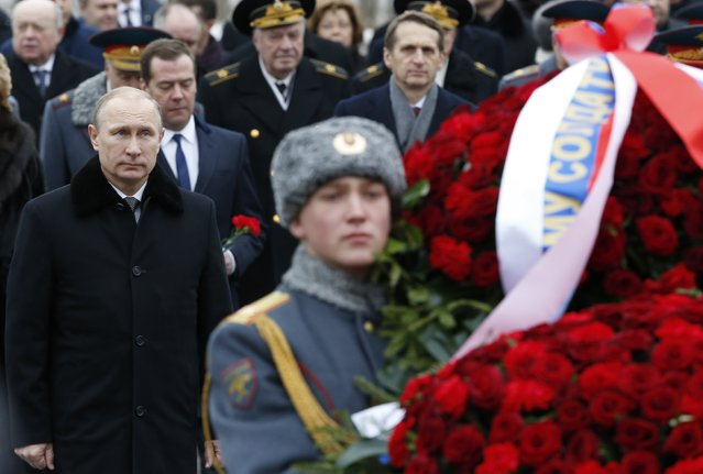 Russian President Vladimir Putin (L) attends a wreath laying ceremony to mark the Defender of the Fatherland Day at the Tomb of the Unknown Soldier by the Kremlin walls in central Moscow February 23, 2015. (Photo by Sergei Karpukhin/Reuters)