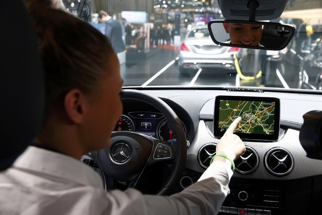 An employee shows the navigation system of a Mercedes-Benz B-class Electric Drive during the first press day ahead of the 85th International Motor Show in Geneva March 3, 2015. REUTERS/Arnd Wiegmann