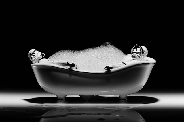 Two storm troopers lie in a bath, taken in Glasgow, Scotland, December 2016. (Photo by David Gilliver/Barcroft Images)