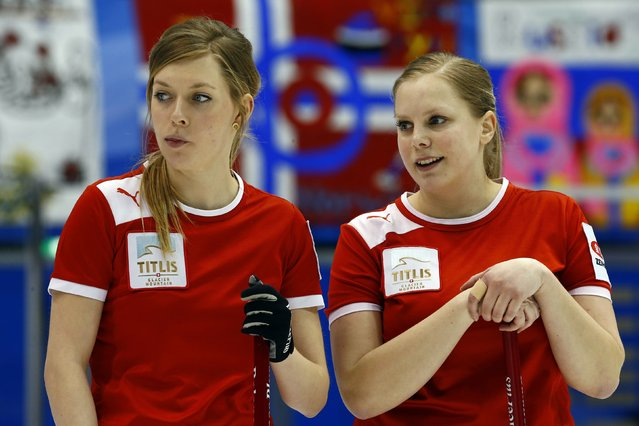 Denmark's Charlotte Clemmensen (L) and Jeanne Ellegaard watch their opponents play during their curling round robin game against Switzerland during the World Women's Curling Championships in Sapporo March 16, 2015. (Photo by Thomas Peter/Reuters)