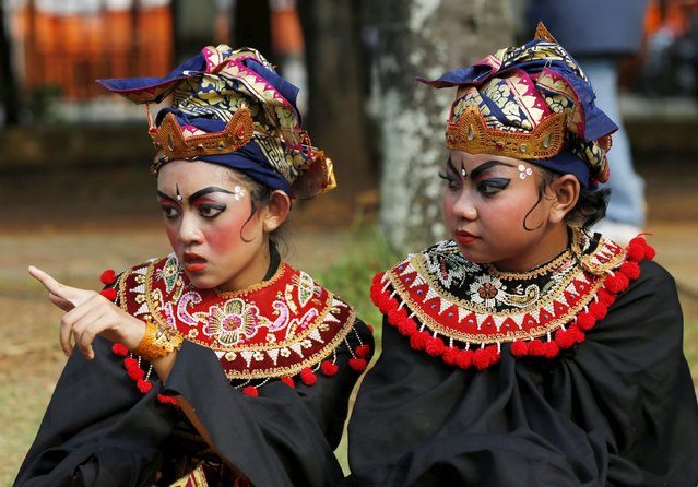 Balinese Hindu dancers take a rest after a ritual before Nyepi day in Jakarta March 20, 2015. (Photo by Reuters/Beawiharta)
