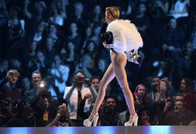 Singer Miley Cyrus walks on stage during the 2013 MTV Europe Music Awards at the Ziggo Dome in Amsterdam on November 10, 2013. (Photo by Reuters)