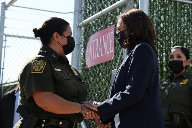Vice President Kamala Harris speaks with Gloria Chavez, Chief Patrol Agent of the El Paso Sector, as she visits El Paso central processing center in El Paso, Texas, June 25, 2021. (Photo by Evelyn Hockstein/Reuters)