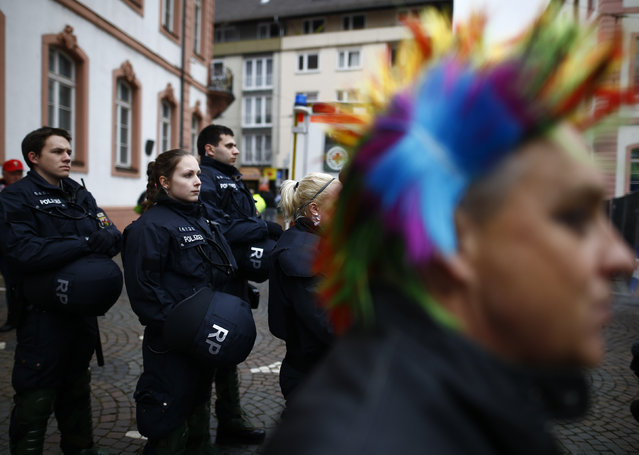"""Police patrol as revellers take part in the traditional """"Weiberfastnacht"""" (Women's Carnival) celebration in Mainz, Germany, February 4, 2016. (Photo by Kai Pfaffenbach/Reuters)"""