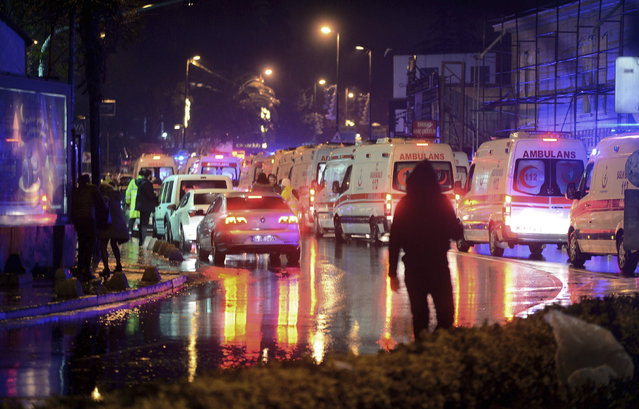 Medics and security officials work at the scene after an attack at a popular nightclub in Istanbul, early Sunday, January 1, 2017. (Photo by IHA via AP Photo)