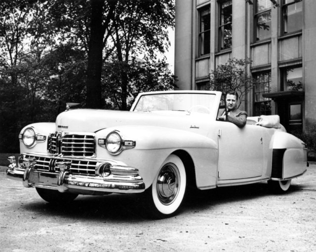 In this June 1946 file photo, Henry Ford II, grandson of Ford Motor Co. founder Henry Ford, is seated in a Ford Lincoln Continental. (Photo by AP Photo/Ford Motor Co.)