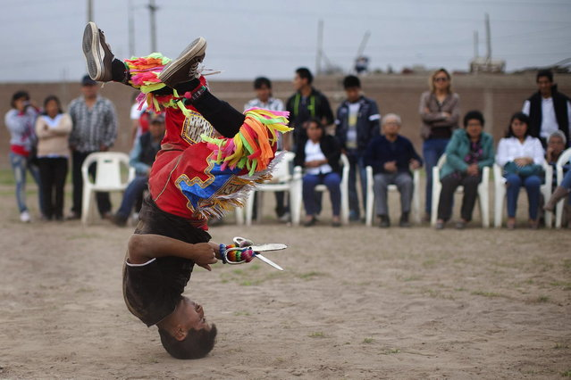 "A ""scissors"" dancer performs in a national scissors dance competition in the outskirts of Lima December 1, 2013. (Photo by Enrique Castro-Mendivil/Reuters)"