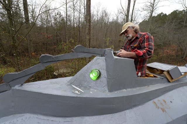 "Danny McWilliams, 56, works on his 36-foot-long replica of Walt Disney movie version of the Nautilus submarine from Jules Verne's ""20,000 Leagues Under the Sea"" at his rural home in Ellijay, Georgia, USA, 04 December 2013. (Photo by Erik S. Lesser/EPA)"
