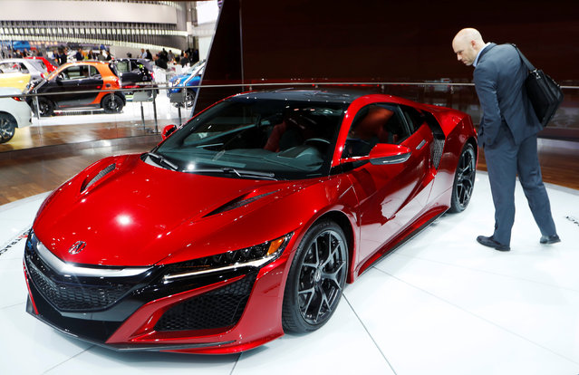 A man looks at the 2017 Acura NSX during the North American International Auto Show in Detroit, Michigan, U.S., January 10, 2017. (Photo by Mark Blinch/Reuters)