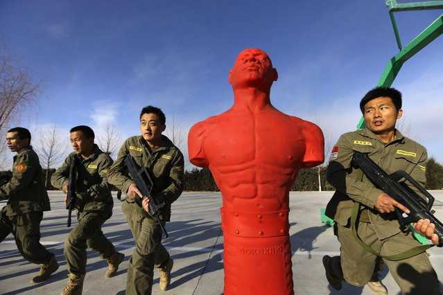 Trainees hold replica 95 semi-automatic rifles as they take part in Tianjiao Special Guard/Security Consultant training on the outskirts of Beijing December 11, 2013. (Photo by Jason Lee/Reuters)