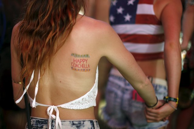 "A woman displays a temporary ""Happy Coachella"" tattoo at the Coachella Valley Music and Arts Festival in Indio, California April 11, 2015. (Photo by Lucy Nicholson/Reuters)"