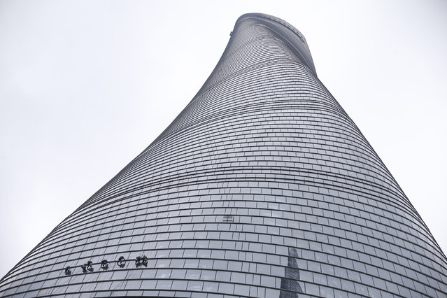 Workers clean the exterior of skyscraper Shanghai Tower at the financial district of Pudong in Shanghai, China, February 23, 2016. (Photo by Aly Song/Reuters)