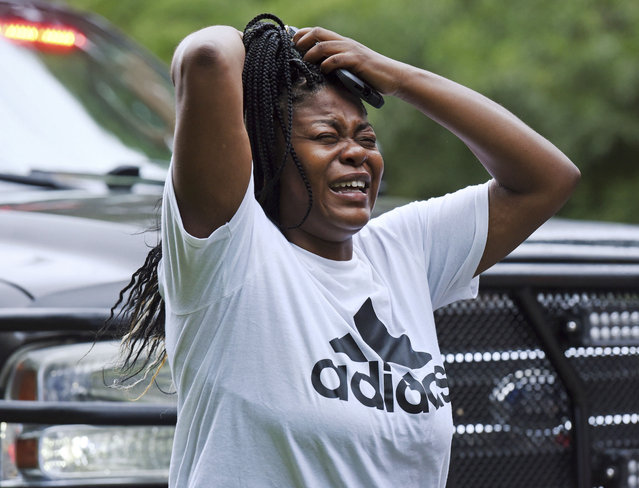 """""""Oh my God! One is dead!"""" a woman screams as she arrives at Mount Tabor High School in Winston-Salem, N.C., 30 minutes after the call of shots fired at the school, Wednesday, September 1, 2021. (Photo by Walt Unks/Winston-Salem Journal via AP Photo)"""