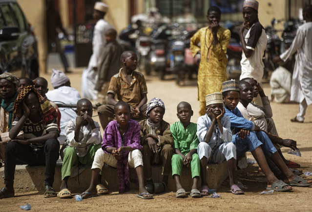 Young Muslim boys wait for traditional Friday prayers to begin at a mosque near to the Emir's palace a day prior to the start of the elections, in Kano, northern Nigeria, Friday, February 15, 2019. (Photo by Ben Curtis/AP Photo)