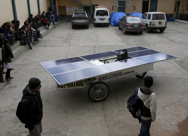 A prototype of a solar car built by students at the El Alto public university, is seen during a test in El Alto April 23, 2015. Students of mechanical and electronic systems, technology school,  built the solar car for a contest sponsored by the Bolivian government. (Photo by David Mercado/Reuters)