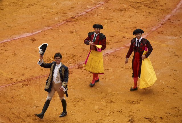 Portuguese rejoneador (mounted bullfighter) Joao Moura (L) celebrates his performance next to his assistants during a bullfight at The Maestranza bullring in the Andalusian capital of Seville, southern Spain April 26, 2015. (Photo by Marcelo del Pozo/Reuters)
