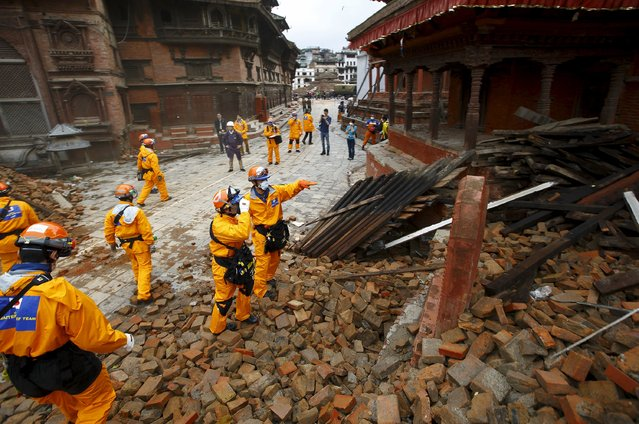 Japanese rescue team members observe the affected areas upon their arrival after the earthquake in Kathmandu, Nepal April 28, 2015. (Photo by Navesh Chitrakar/Reuters)