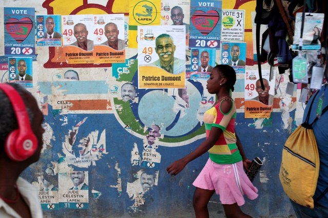 Residents walk past electoral posters in Port-au-Prince, Haiti, January 28, 2017. (Photo by Andres Martinez Casares/Reuters)