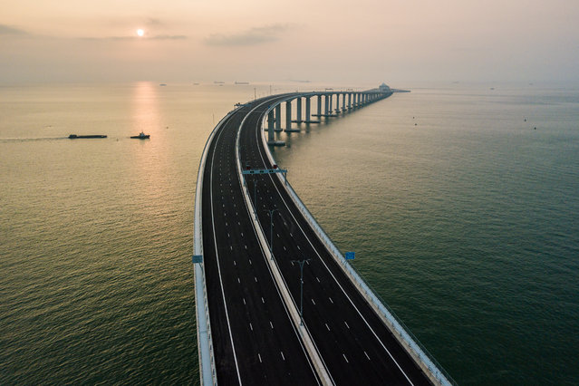 An aerial view taken on October 22, 2018, shows a section of the Hong Kong-Zhuhai-Macau Bridge (HKZM) in Hong Kong. The world's longest sea-bridge connecting Hong Kong, Macau and mainland China will be launched October 23, at a time when Beijing seeks to tighten its grip on its territories. (Photo by Anthony Wallace/AFP Photo)