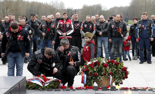 "Members of the Night Wolves motorcycle club and other local Belarusian bikers visit the war memorial ""Khatyn"" during a bike ride commemorating the 70th anniversary of the victory over Nazi Germany in World War Two, northeast of Minsk April 26, 2015. (Photo by Vasily Fedosenko/Reuters)"