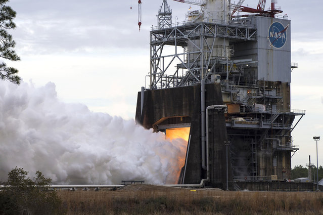 NASA followed up the first RS-25 test of 2018 with a second hot fire of the Space Launch System (SLS) engine on February 1 at Stennis Space Center near Bay St. Louis, Mississippi. The full-duration, 365-second certification test of another RS-25 engine flight controller on the A-1 Test Stand at Stennis comes about two weeks after a Jan. 16 hot fire. The test marks completion of green run testing for all four of the new RS-25 engine flight controllers needed for the second flight of NASA's SLS rocket. NASA is building SLS to send humans to such deep-space destinations as the moon and Mars. The Exploration Mission-1 (EM-1) flight will test the new rocket and carry an uncrewed Orion spacecraft into space beyond the moon. Exploration Mission-2 (EM-2) will be the first flight to carry humans aboard the Orion spacecraft, returning astronauts to deep space for the first time in more than 40 years. (Photo by NASA)