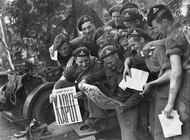 Gunners of the 12th Field Regiment, Royal Canadian Artillery (RCA), are shown with the Victory issue of the Maple Leaf newspaper, in Aurich, Germany, on May 20, 1945, in this handout photo provided by Library and Archives Canada. (Photo by Lieut. Donald I. Grant/Reuters/Canada Department of National Defence/Library and Archives Canada)