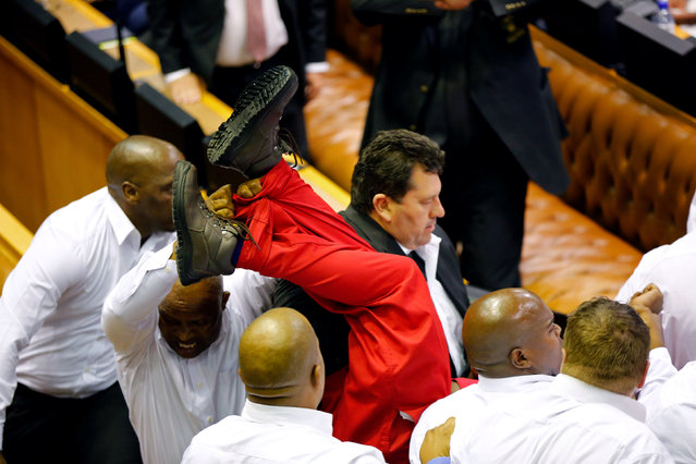 Security officials remove members of the Economic Freedom Fighters during President Jacob Zuma's State of the Nation Address (SONA) to a joint sitting of the National Assembly and the National Council of Provinces in Cape Town, South Africa February 9, 2017. (Photo by Sumaya Hisham/Reuters)