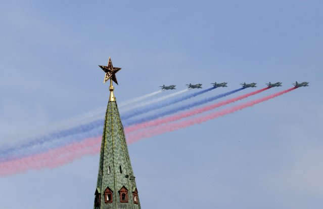 SU-25 military jets fly in formation during the Victory Day parade above Red Square in Moscow, Russia, May 9, 2015. (Photo by Tatyana Makeyeva/Reuters)