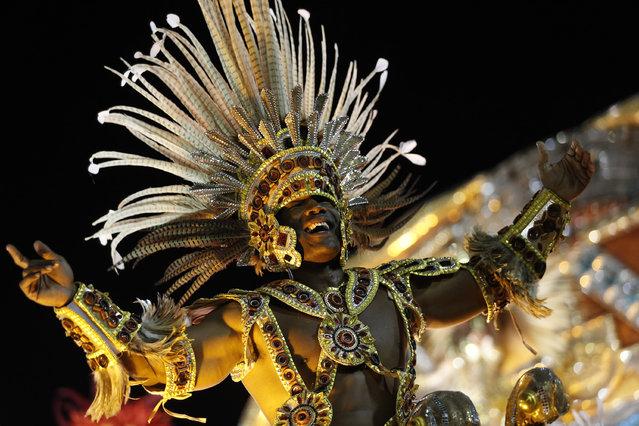 A performer from the Academicos do Grande Rio samba school parades during carnival celebrations at the Sambadrome in Rio de Janeiro, Brazil, Sunday, March 2, 2014. (Photo by Silvia Izquierdo/AP Photo)