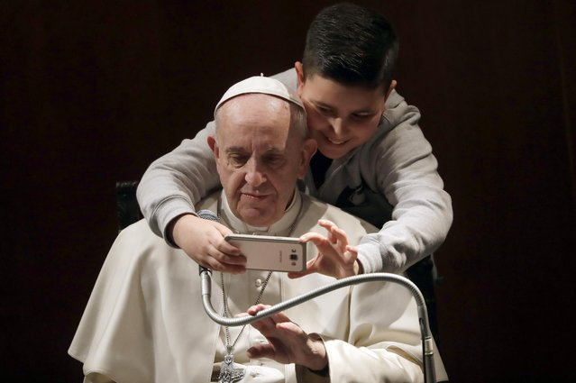 A boy takes a selfie with Pope Francis, during a visit to the parish of Santa Maria Josefa del Cuore di Gesu', in Rome, Sunday, February 19, 2017. (Photo by Alessandra Tarantino/AP Photo)
