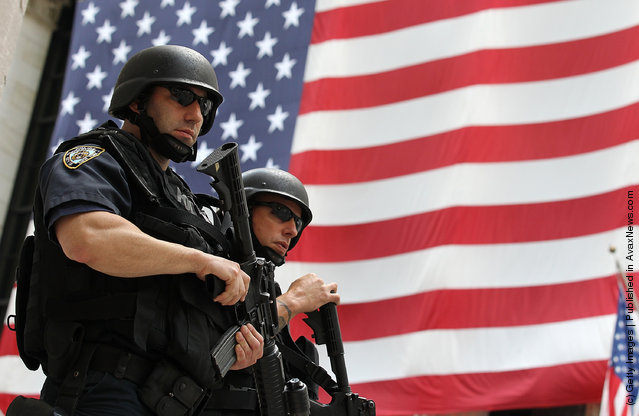 New York Police Department  tactical police officers stand guard near the New York Stock Exchange