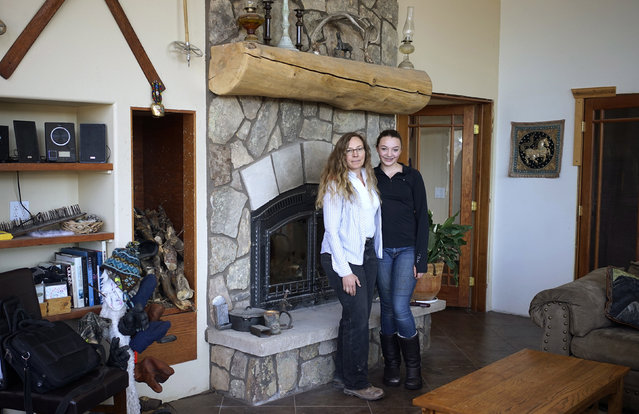 Denise Arthur, 52, and her daughter Linnaea Thibedeau, 13, pose for a photograph at their home near Blackhawk, Colorado February 20, 2014. Denise Arthur is a restoration ecologist. She has a Ph.D and finished her education at age 34. Her ambition as a child was to be an animal behaviourist. Denise hopes her daughter Linnaea will become a biologist when she grows up. Linnaea would like to get a Ph.D and become a marine biologist. (Photo by Rick Wilking/Reuters)