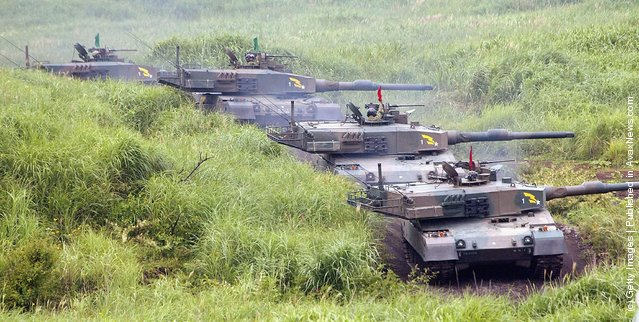 Tanks line up ready to fire shells at the foot of Mount Fuji during an exercise by the Japanese Defense Agency (JDA)