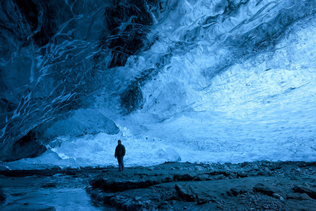 A wide view of Rob Lott  in the crystal ice cave in the Vatnajokull Glacier, Iceland. (Photo by Rob Lott/Barcroft Media)