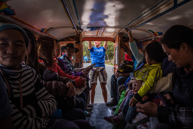 It used to be quite common to ride on the roof of a jeepney, as public transport in the countryside is very limited. Riding on top is now prohibited, but this passenger told us that hanging out of the back is just fine! (Photo by Claudio Sieber/Barcroft Media)