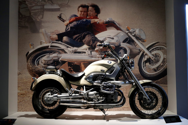"""An BMW motorcycle from the James Bond film """"Tomorrow Never Dies"""" is displayed during a press presentation of the exhibition """"The Designing 007: Fifty Years of Bond Style"""" at the Grande Halle de la Villette in Paris, France, April 13, 2016. (Photo by Benoit Tessier/Reuters)"""