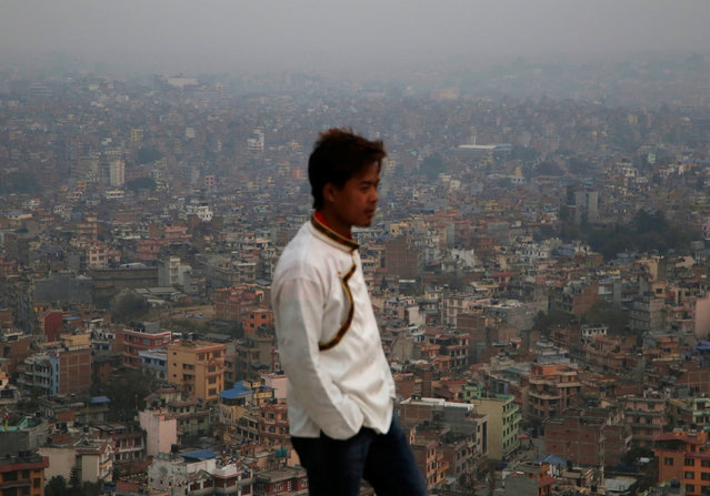 A man stands in a view point as a general view of Kathmandu valley is picture covered from smog in Kathmandu, Nepal February 27, 2017. (Photo by Navesh Chitrakar/Reuters)