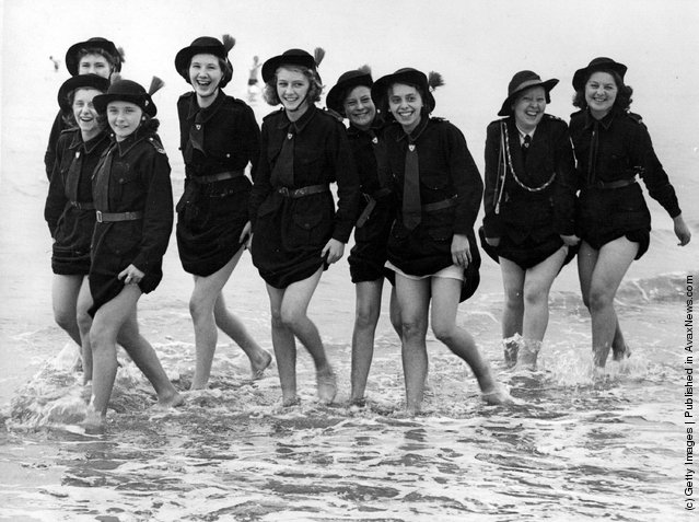 1939: Girls of the 7th Manchester Regiment Church Girls Brigade (Rochdale Battalion) who are in camp at Bridlington, making the most of their holiday by the sea