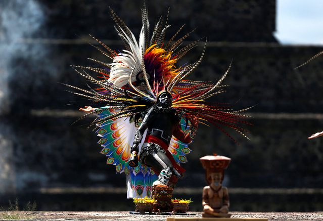 A performer is seen during the new fire ceremony for the Pan American Games Lima 2019 in Teotihuacan, Mexico on July 2, 2019. (Photo by Gustavo Graf/Reuters)