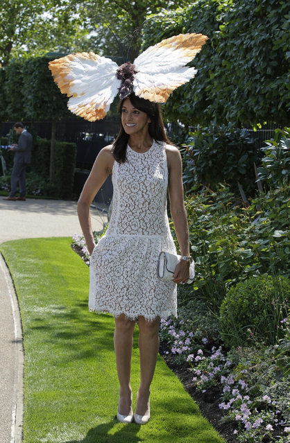 Jackie St Clair poses for photographers as she arrives for the first day of  Royal Ascot horse racing meet at Ascot, England, Tuesday, June 16, 2015. Royal Ascot is the annual five day horse race meeting that Britain's Queen Elizabeth II attends every day of the event.(AP Photo/Alastair Grant)
