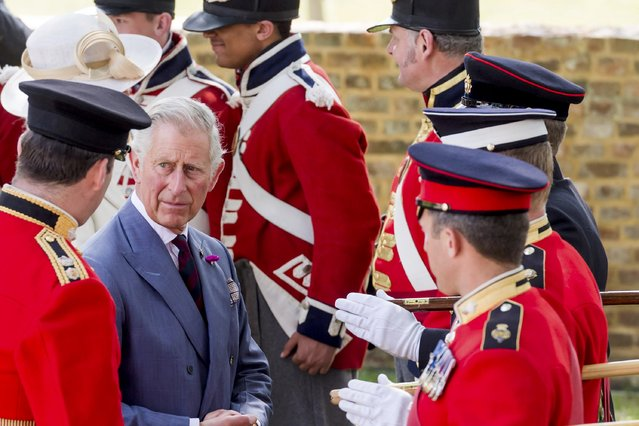 Britain's Prince Charles speaks with the troops during a ceremony for the opening of the Hougoumont farm as part of the bicentennial celebrations for the Battle of Waterloo, near Waterloo, Belgium June 17, 2015. The commemorations for the 200th anniversary of the Battle of Waterloo will take place in Belgium on June 19 and 20. REUTERS/Geert Vanden Wijngaert/Pool