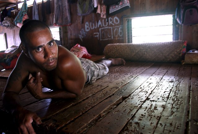 A prisoner lies on his bed inside the sleeping dormitory of a prison located on Kiritimati Island, part of the Pacific Island nation of Kiribati, April 5, 2016. (Photo by Lincoln Feast/Reuters)