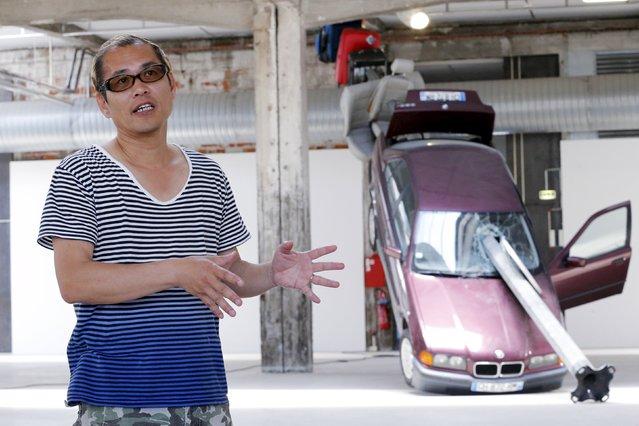 "Japanese artist Taturo Atzu alias Tatzu Nishi talks to the media during a media visit to ""A Journey to Nantes"" (Le Voyage a Nantes) art festival in Nantes, France, June 30, 2015. (Photo by Stephane Mahe/Reuters)"