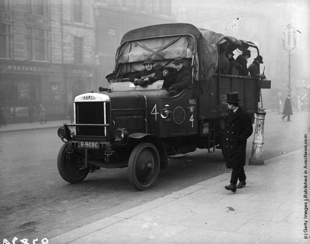 1919: Motor lorries being used to transport passengers during a tube strike in London