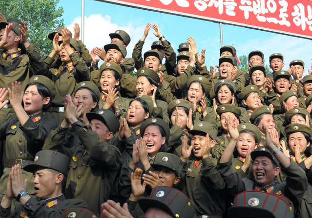 North Korean soldiers applaud as North Korean leader Kim Jong-Un (not pictured) visits a sub-unit under the Korean People's Army Unit 552 in this undated picture released by the North's official KCNA news agency in Pyongyang August 7, 2012. (Photo by Reuters/KCNA)