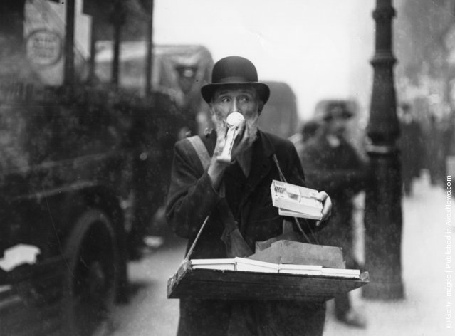 At Christmas toy hawkers, like this one on Ludgate Hill and Holborn, thronged the streets of London, 1913
