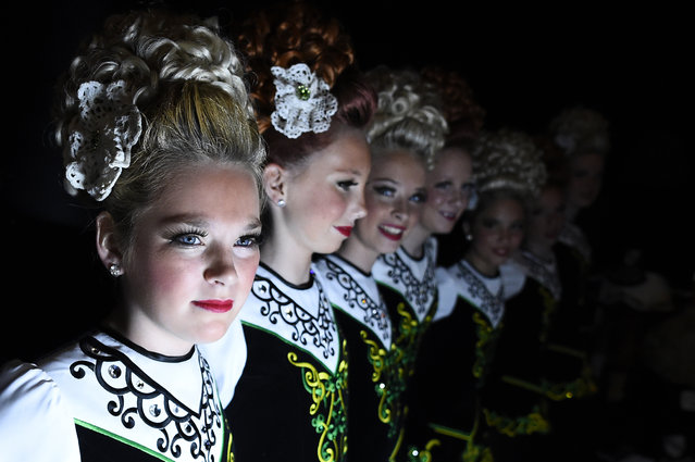 Dancers wait backstage before performing during the World Irish Dancing Championships in Dublin, Ireland on April 11, 2017. (Photo by Clodagh Kilcoyne/Reuters)