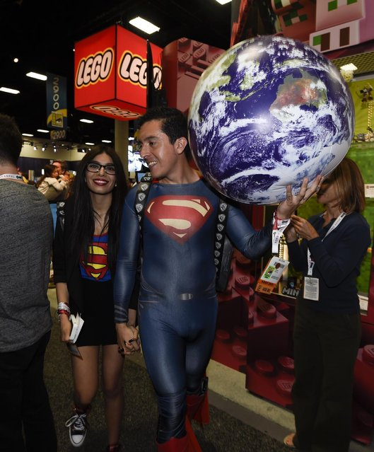 Bersain Gutierrez, dressed as Superman, and Belinda Sainz walk through the exhibit hall on Preview Night at Comic-Con International held at the San Diego Convention Center Wednesday July 8, 2015 in San Diego. (Photo by Denis Poroy/Invision/AP Photo)